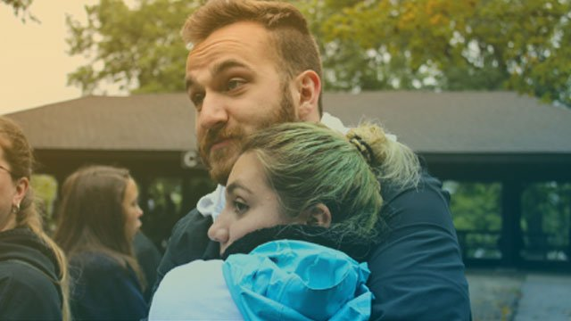Donate Today: Couple hugging at the Walk N' Roll 2018